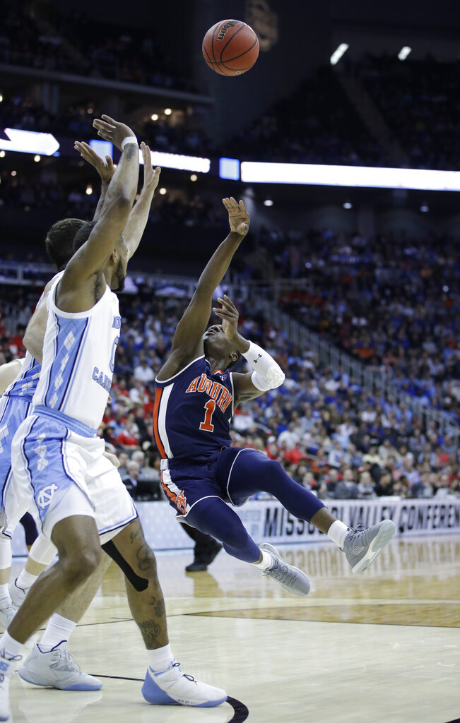 Auburn's Jared Harper (1) puts up a shot as North Carolina's Seventh Woods defends during the second half of a men's NCAA tournament college basketball Midwest Regional semifinal game Friday, March 29, 2019, in Kansas City, Mo. (AP Photo/Charlie Riedel)