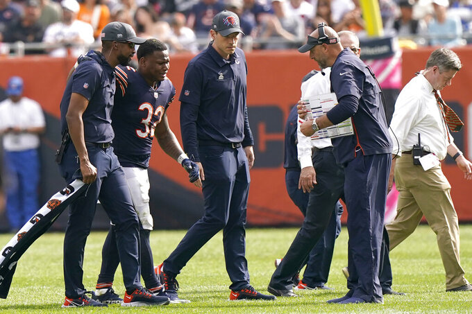 Chicago Bears head coach Matt Nagy, right, looks at running back David Montgomery (32) as he leaves the field after being injured during the second half of an NFL football game against the Detroit Lions Sunday, Oct. 3, 2021, in Chicago. (AP Photo/Nam Y. Huh)
