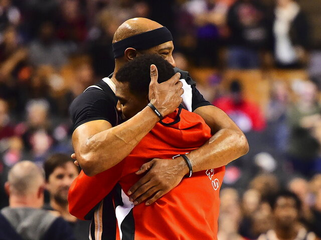 Atlanta Hawks guard Vince Carter hugs Toronto Raptors guard Kyle Lowry, after Lowry became the franchise leader in assists, during the second half of an NBA basketball game Tuesday, Jan. 28, 2020, in Toronto. (Frank Gunn/The Canadian Press via AP)