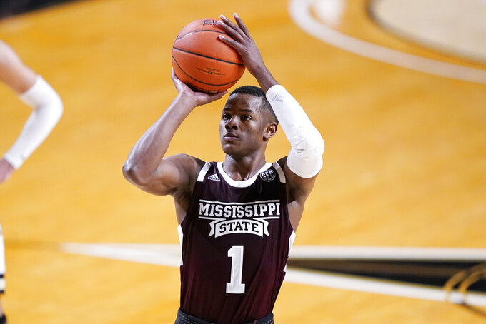 FILE - Mississippi State guard Iverson Molinar (1) plays against Vanderbilt in the second half of an NCAA college basketball game in Nashville, Tenn., in this Saturday, Jan. 9, 2021, file photo. Ben Howland believes Mississippi State could be one of his best squads since arriving in Starkville. Molinar's offense was key to the Bulldogs' NIT run, and he's a preseason All-SEC first team selection. (AP Photo/Mark Humphrey, File)