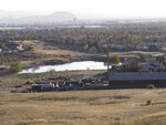 This Thursday, Oct. 31, 2019 photo, shows a pond on the former D'Andrea Golf Course in Sparks, Nev., with one of 14 dam structures that the state considers to be a high hazard and in either poor or unsatisfactory condition. Nevada is one of fewer than 10 states nationwide that refuses to make public the emergency action plans for dams outlining threats to residents downstream based on the argument they could become terrorist targets. (AP Photo/Scott Sonner)