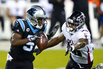 Carolina Panthers quarterback Teddy Bridgewater looks to pass under pressure from Atlanta Falcons defensive end Dante Fowler Jr. during the first half of an NFL football game Thursday, Oct. 29, 2020, in Charlotte, N.C. (AP Photo/Gerry Broome)