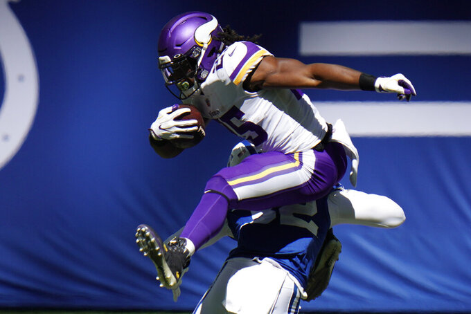 Minnesota Vikings' Alexander Mattison (25) is tackled by Indianapolis Colts' Julian Blackmon (32) during the first half of an NFL football game, Sunday, Sept. 20, 2020, in Indianapolis. (AP Photo/AJ Mast)