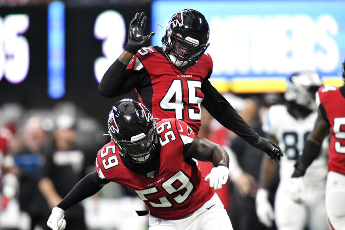Atlanta Falcons' De'Vondre Campbell (59) and Deion Jones (45) celebrate the sacking of Carolina Panthers quarterback Kyle Allen during the first half of an NFL football game, Sunday, Dec. 8, 2019, in Atlanta. (AP Photo/Danny Karnik)