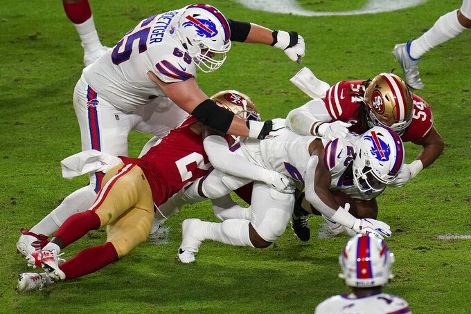 Buffalo Bills running back Zack Moss, center, is hit by San Francisco 49ers middle linebacker Fred Warner (54) and San Francisco 49ers cornerback Jason Verrett during the first half of an NFL football game, Monday, Dec. 7, 2020, in Glendale, Ariz. (AP Photo/Ross D. Franklin)