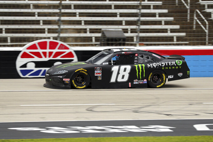 NASCAR Xfinity Series driver Riley Herbst (18) goes down the front stretch during a NASCAR Xfinity Series auto race at Texas Motor Speedway in Fort Worth, Texas, Saturday Oct. 24, 2020. (AP Photo/Richard W. Rodriguez)