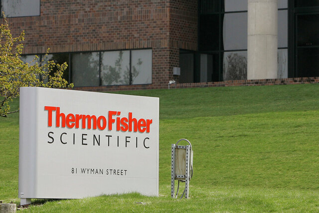 FILE - This April 26, 2007, file photo, shows the exterior of Thermo Fisher Scientific Inc., of Waltham, Mass.  Thermo Fisher Scientific Inc., a maker of scientific instrument and laboratory supplies, is buying Qiagen in a deal valued at about $10.1 billion, reported Tuesday, March 3, 2020. Qiagen NV is a provider of molecular diagnostics and sample preparation technologies. The Netherlands-based company has approximately 5,100 workers at 35 locations in more than 25 countries.  The deal is expected to close in the first half of 2021.  (AP Photo/Stephan Savoia, File)