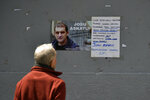 A man looks at a poster with the face of Basque separatist militant Josu Ternera, in his home town of Ugao-Miraballes, Spain, Thursday, May 16, 2019. The most wanted member of the Basque separatist militant group ETA who had been on the run for 17 years was finally caught by police on Thursday May 16, 2019 in the French Alps. Jose Antonio Urruticoetxea Bengoetxea, known by the alias Josu Ternera, was a longtime chief of ETA and connected to some of its bloodiest episodes. The poster has a message written in the Basque language saying 'No solution to the solution' while calling for a protest gathering in the town this evening supporting him. (AP Photo/Alvaro Barrientos)