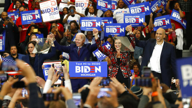 FILE - In this March 9, 2020, file photo, Sen. Kamala Harris, D-Calif., from left, Democratic presidential candidate former Vice President Joe Biden, Michigan Gov. Gretchen Whitmer, and Sen. Cory Booker D-N.J. greet the crowd during a campaign rally in Detroit. Whitmer's quick ascension to the national stage — and on Biden's list of potential running mates — has left Democrats both thankful she will continue to lead Michigan after he chose Kamala Harris but also excited about what the governor's future may hold. (AP Photo/Paul Sancya, File)