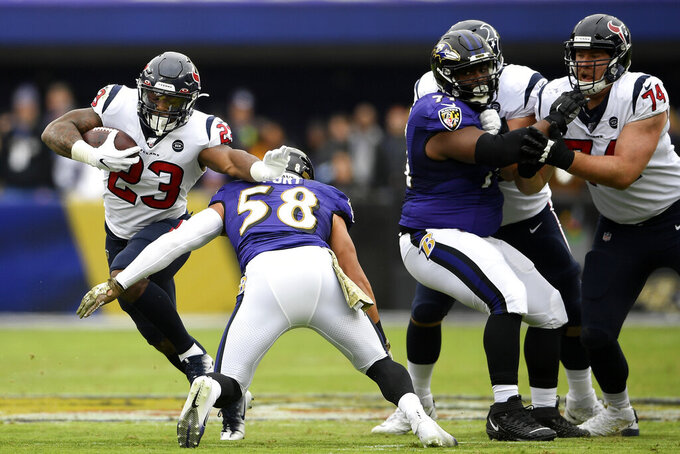 Houston Texans running back Carlos Hyde (23) runs with the ball as Baltimore Ravens linebacker L.J. Fort (58) prepares to make the tackle during the first half of an NFL football game, Sunday, Nov. 17, 2019, in Baltimore. (AP Photo/Nick Wass)