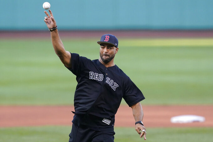 New England Patriots football player Kyle Van Noy throws a ceremonial first pitch before a baseball game between the Boston Red Sox and the New York Yankees at Fenway Park, Friday, July 23, 2021, in Boston. (AP Photo/Elise Amendola)