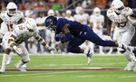 Rice running back Aston Walter (1) is upended as he dives for yards past Texas defensive back Brandon Jones (19) during the second half of an NCAA college football game Saturday, Sept. 14, 2019, in Houston. (AP Photo/Eric Gay)