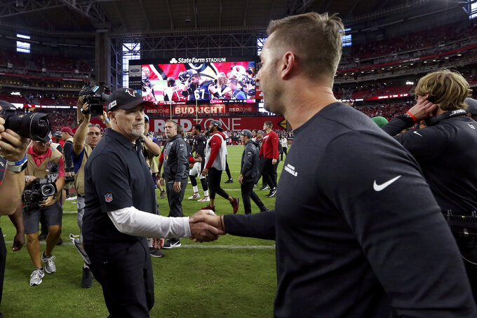 Atlanta Falcons head coach Dan Quinn, left, greets Arizona Cardinals head coach Kliff Kingsbury after an NFL football game, Sunday, Oct. 13, 2019, in Glendale, Ariz. The Cardinals won 34-33. (AP Photo/Ross D. Franklin)