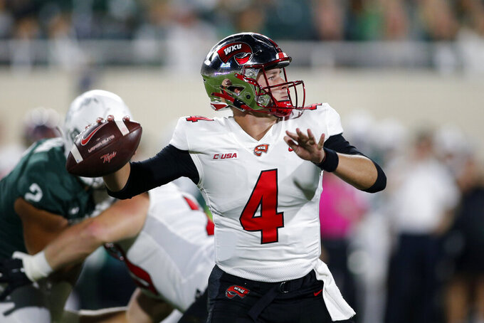 Western Kentucky quarterback Bailey Zappe looks to throw a pass against Michigan State during the first quarter of an NCAA college football game, Saturday, Oct. 2, 2021, in East Lansing, Mich. (AP Photo/Al Goldis)