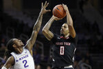 Texas Tech guard Kyler Edwards (0) shoots over Kansas State guard Cartier Diarra (2) during the first half of an NCAA college basketball game in Manhattan, Kan., Tuesday, Jan. 14, 2020. (AP Photo/Orlin Wagner)