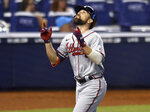 Atlanta Braves' Ender Inciarte (11) looks up as he crosses home plate after hitting a home run against the Miami Marlins during the sixth inning of a baseball game, Sunday, June 13, 2021, in Miami. (AP Photo/Jim Rassol)