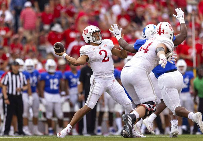 Nebraska quarterback Adrian Martinez (2) makes a 68-yard pass to Samori Toure for a touchdown in the second half of an NCAA college football game, Saturday, Sept. 11, 2021, at Memorial Stadium in Lincoln, Neb. (AP Photo/Rebecca S. Gratz)