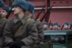 Russian soldiers dressed in Red Army World War II winter uniforms sit in trucks as they wait to take a part in a reconstruction of a World War II-era parade in Moscow's Red Square, Russia, Thursday, Nov. 7, 2019. The Nov. 7, 1941 parade saw Red Army soldiers move directly to the front line in the Battle of Moscow, becoming a symbol of Soviet valor and tenacity in the face of overwhelming odds. (AP Photo/Alexander Zemlianichenko)