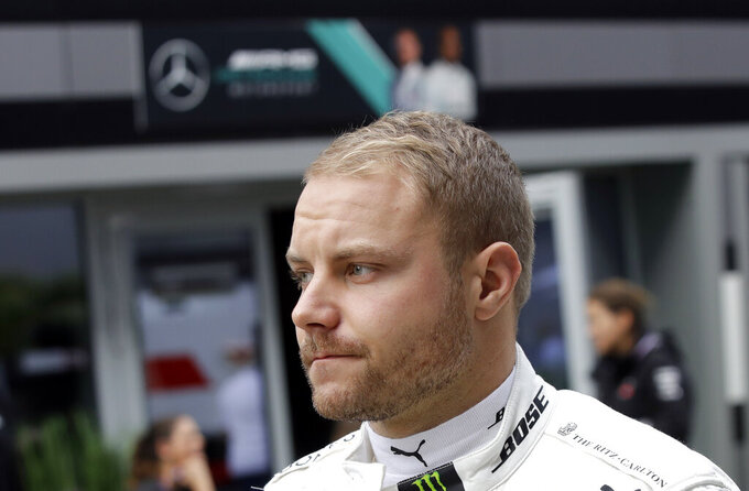 Mercedes driver Valtteri Bottas of Finland walks through the paddock prior to the start of the first free practice at the 'Sochi Autodrom' Formula One circuit, in Sochi, Russia, Friday, Sept. 27, 2019. The Formula one race will be held on Sunday. (AP Photo/Luca Bruno)