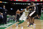 Boston Celtics guard Kyrie Irving (11) makes a move against Washington Wizards center Thomas Bryant as Celtics coach Brad Stevens, left, watches during the first quarter of an NBA basketball game Friday, March 1, 2019, in Boston. (AP Photo/Elise Amendola)