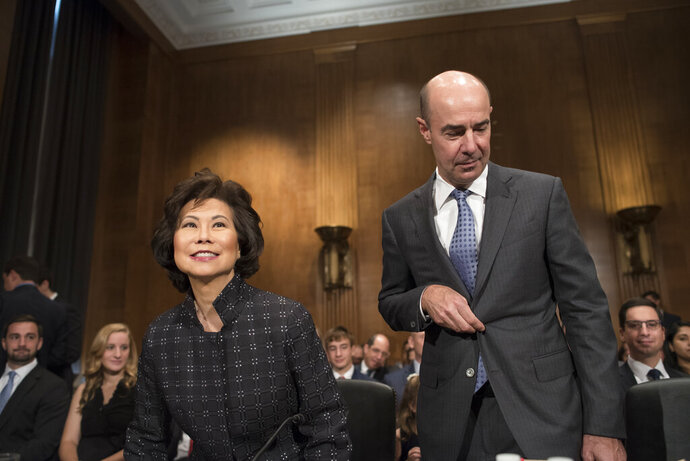 Eugene Scalia takes his seat for his nomination hearing for Labor Secretary with Transportation Secretary Eliane Chao, left, on Capitol Hill, in Washington, Thursday, Sept. 19, 2019. (AP Photo/Cliff Owen)