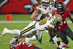 New Orleans Saints running back Latavius Murray (28) is upended by Tampa Bay Buccaneers strong safety Antoine Winfield Jr. (31) during the second half of an NFL football game Sunday, Nov. 8, 2020, in Tampa, Fla. (AP Photo/Jason Behnken)