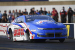 In this photo provided by the NHRA, Pennsylvania native and Pro Stock rising star Kyle Korestsky kicks off qualifying at the Mopar Express Lane NHRA Nationals drag races at Maple Grove Raceway in Mohnton, Pa., Friday, Sept. 10, 2021. (Marc Gewertz/NHRA via AP)