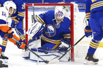 Buffalo Sabres goalie Michael Houser (32) makes a save in traffic during the second period of an NHL hockey game against the New York Islanders, Tuesday, May 4, 2021, in Buffalo, N.Y. (AP Photo/Jeffrey T. Barnes)