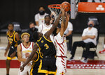 Arkansas-Pine Bluff forward Markedric Bell, center, defends against a shot by Iowa State guard Jaden Walker, right, during the second half of an NCAA college basketball game, Sunday, Nov. 29, 2020, in Ames, Iowa. (AP Photo/Matthew Putney)
