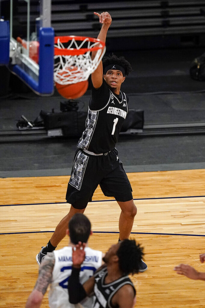 Georgetown's Jamorko Pickett (1) watches his shot during the first half of the team's NCAA college basketball game against Seton Hall in the semifinals in the Big East men's tournament Friday, March 12, 2021, in New York. (AP Photo/Frank Franklin II)