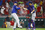 Texas Rangers relief pitcher Shawn Kelley, left, celebrates with catcher Jeff Mathis after the team's baseball game against the Cincinnati Reds, Saturday, June 15, 2019, in Cincinnati. (AP Photo/John Minchillo)