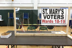 This April 6, 2020 photo provided by Scott Trindl shows one of the tables, fitted with protective plexiglass, at the sole polling location for city of Waukesha, Wis., residents. Wisconsin Gov. Tony Evers on Monday, April 6, 2020 moved to postpone the state's presidential primary for two months because of the coronavirus pandemic, prompting a court challenge and adding to confusion about whether voters will be able to head to the polls on Tuesday. (Scott Trindl via AP)