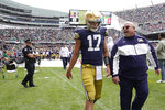 Notre Dame quarterback Jack Coan heads to the locker room after an injury during the second half of an NCAA college football game against Wisconsin Saturday, Sept. 25, 2021, in Chicago. Coan did not return to play. (AP Photo/Charles Rex Arbogast)