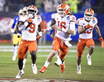 Clemson's Travis Etienne (9) runs for a touchdown against Pittsburgh as Trevor Lawrence (16) follows in the first half of the Atlantic Coast Conference championship NCAA college football game in Charlotte, N.C., Saturday, Dec. 1, 2018. (AP Photo/Mike McCarn)