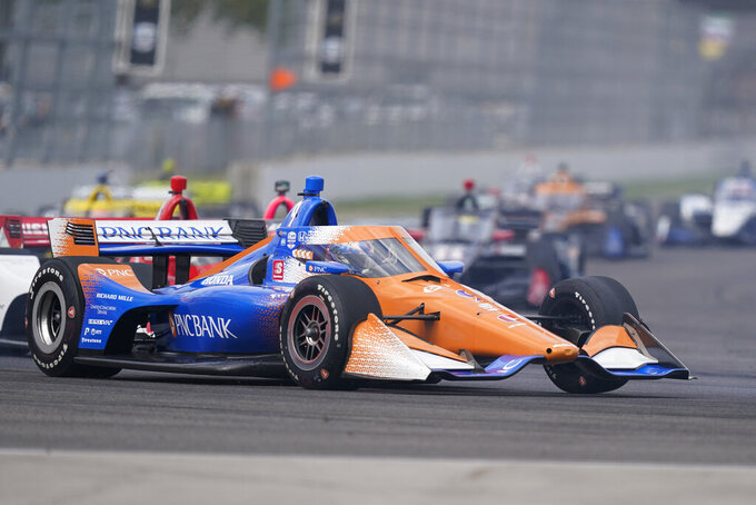 Scott Dixon, of New Zealand, drives into a turn during an IndyCar auto race at Indianapolis Motor Speedway, Friday, Oct. 2, 2020, in Indianapolis. (AP Photo/Darron Cummings)