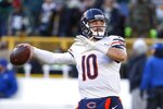 """FILE - In this Dec. 15, 2019, file photo, Chicago Bears' Mitchell Trubisky warms up before an NFL football game against the Green Bay Packers, in Green Bay, Wis. Trubisky understands why the Bears acquired quarterback Nick Foles. That doesn't mean he's ready to hand over the starting job. Trubisky said the trade for Foles gave him extra motivation to show he can develop into the franchise quarterback the Bears thought he would become when they moved up a spot to draft him with the No. 2 overall pick in 2017.  """"That's the business we're in,"""" he said in a conference call on Friday, June 12, 2020. (AP Photo/Matt Ludtke, File)"""