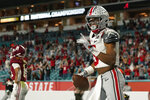 Ohio State wide receiver Garrett Wilson celebrates after scoring against Alabama during the second half of an NCAA College Football Playoff national championship game, Monday, Jan. 11, 2021, in Miami Gardens, Fla. (AP Photo/Lynne Sladky)