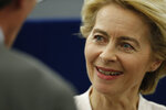 Ursula von der Leyen, the candidate to succeed Jean-Claude Juncker as head of the EU executive, smiles after a debate at the European Parliament in Strasbourg, eastern France, Tuesday July 16, 2019. Ursula von der Leyen is seeking to woo enough legislators at the European Parliament to secure the job of European Commission President in a secret vote late Tuesday. (AP Photo/Jean-Francois Badias)