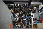 Protesters sit down to block the entrance to the Hong Kong Revenue Tower in Hong Kong on Monday, June 24, 2019. Hong Kong has been rocked by major protests for the past two weeks over legislative proposals that many view as eroding the territory's judicial independence and, more broadly, as a sign of Chinese government efforts to chip away at the city's freedoms. (AP Photo/Kin Cheung)