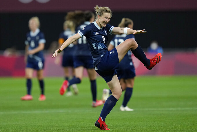 Britain's Ellen White celebrates scoring her side's 2nd goal against Chile during a women's soccer match at the 2020 Summer Olympics, Wednesday, July 21, 2021, in Sapporo, Japan. (AP Photo/Silvia Izquierdo)