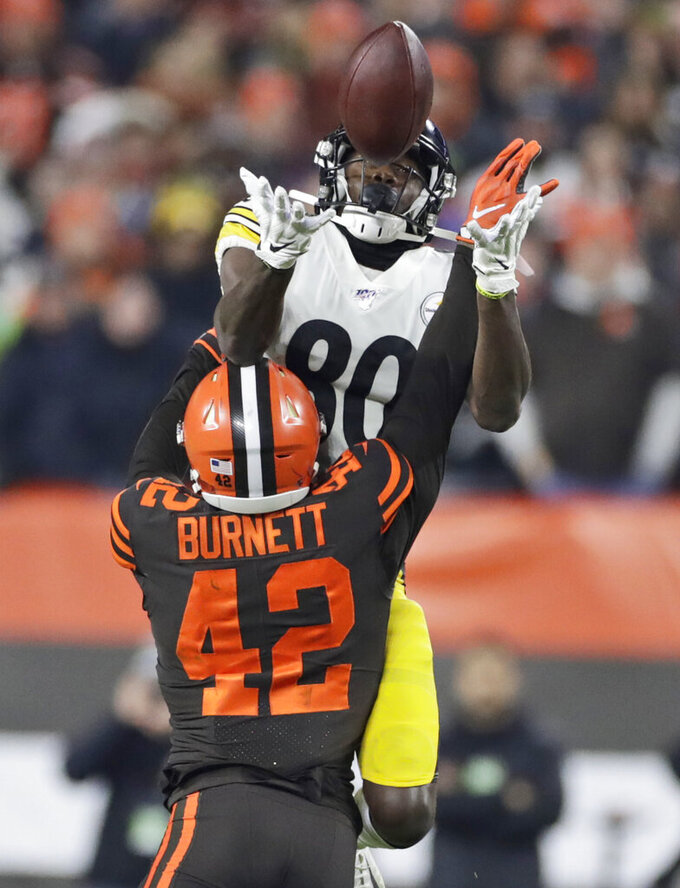 AP Source: Browns S Burnett has torn Achilles, season over