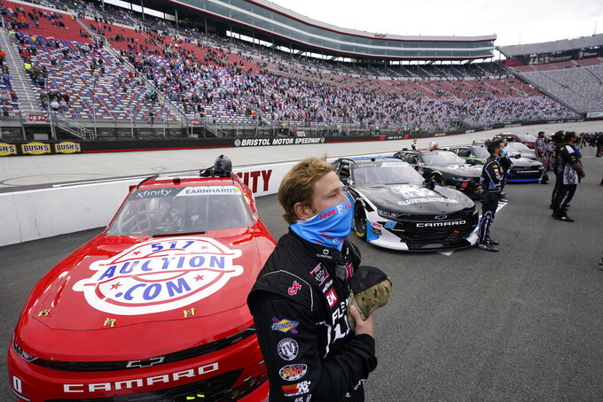 Jeffrey Earnhardt puts his hand over his heart during the national anthem before the NASCAR Xfinity Series auto race Friday, Sept. 18, 2020, in Bristol, Tenn. (AP Photo/Steve Helber)