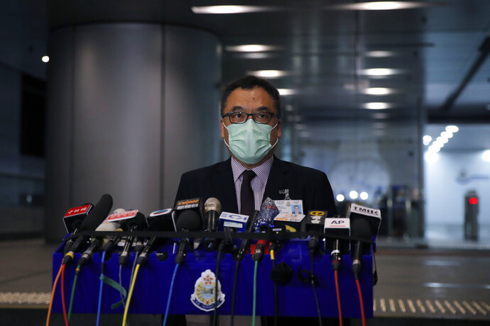Senior Superintendent Li Kwai-wah, Hong Kong Police National Security Department, speaks during a news conference in Hong Kong, Thursday, July 30, 2020. Hong Kong police have made their first major arrests under a new national security law, detaining four young people on suspicion of inciting secession. Police say they arrested three males and one female, aged 16 to 21, at three locations. All are believed to be students. (AP Photo/Kin Cheung)