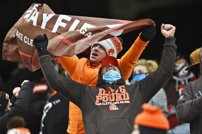 Cleveland Browns fans celebrate after the team defeated the Pittsburgh Steelers in an NFL football game, Sunday, Jan. 3, 2021, in Cleveland. (AP Photo/David Richard)