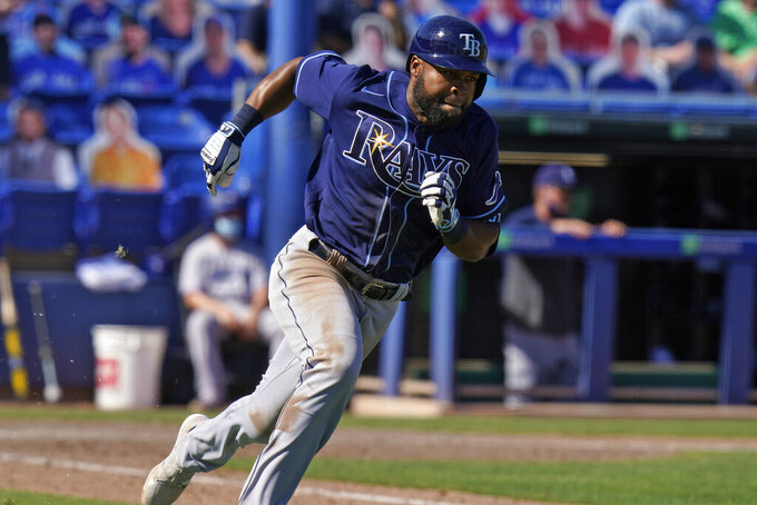 Tampa Bay Rays' Manuel Margot heads for first base after his two-run triple off Toronto Blue Jays relief pitcher Tim Mayza during the 11th inning of a baseball game Monday, May 24, 2021, in Dunedin, Fla. (AP Photo/Chris O'Meara)