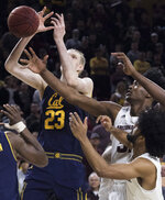 California's Connor Vanover (23) loses the handle on the ball against Arizona State's De'Quon Lake (32) and Remy Martin (1) during the first half of an NCAA college basketball game Sunday, Feb. 24, 2019, in Tempe, Ariz. (AP Photo/Darryl Webb)
