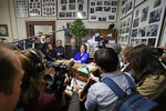 FILE - In this Wednesday, Nov. 6, 2019, file photo, Democratic presidential candidate Sen. Amy Klobuchar, D-Minn., center, speaks to media after filing to be listed on the New Hampshire primary ballot at the Statehouse, in Concord, N.H. The quadrennial chaos has quieted down at the New Hampshire secretary of state's office with the closing of the filing period for the first-in-the-nation presidential primary. (AP Photo/Elise Amendola, File)