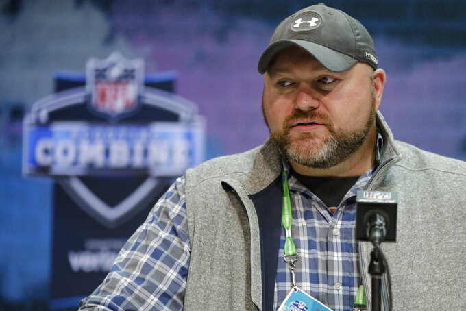 FILE - In this Feb. 25, 2020, file photo, New York Jets general manager Joe Douglas speaks during a news conference at the NFL football scouting combine in Indianapolis. Sam Darnold's time as the face of the New York Jets franchise might be nearing a disappointing end. The 23-year-old quarterback was considered an untouchable player on the roster only a year ago. General manager Joe Douglas has backed off that stance, though, and it could signal a major change at the position as free agency and the NFL draft approach. (AP Photo/Michael Conroy, File)