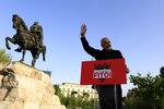 Albania's Prime Minister Edi Rama waves to his supporters during a rally in Tirana, Albania, Tuesday, April 27, 2021. Albania's left-wing Socialist Party has secured a third consecutive mandate in a parliamentary election, winning a majority of seats in parliament, Prime Minister Edi Rama said on Tuesday. (AP Photo/Hektor Pustina)