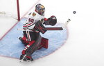 Chicago Blackhawks goalie Corey Crawford (50) makes a save against the Edmonton Oilers during the third period of an NHL hockey playoff game in Edmonton, Alberta, Saturday, Aug. 1, 2020. (Jason Franson/The Canadian Press via AP)